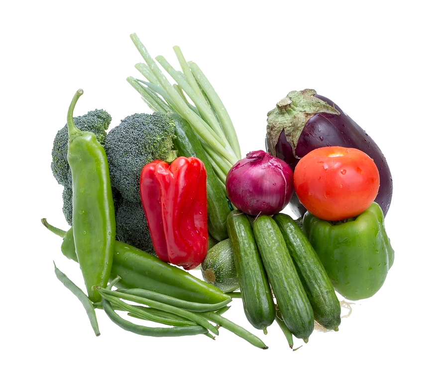 Assorted vegetables isolated on a white background .